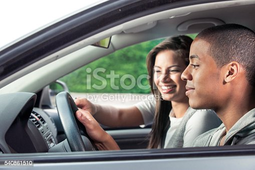 607592606 istock photo Teenagers driving car 540861510