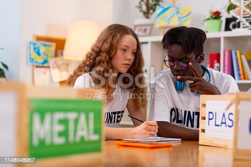 istock Teenagers feeling involved in sorting metal from plastic 1148048957