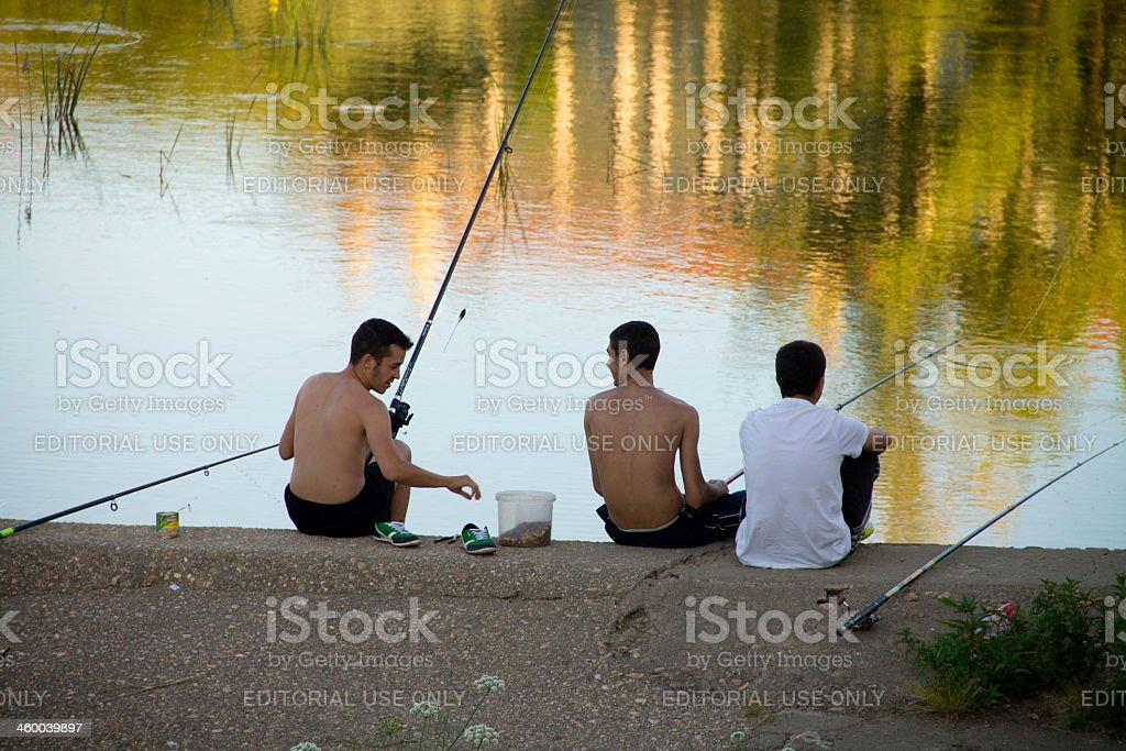 Teenagers fishing stock photo