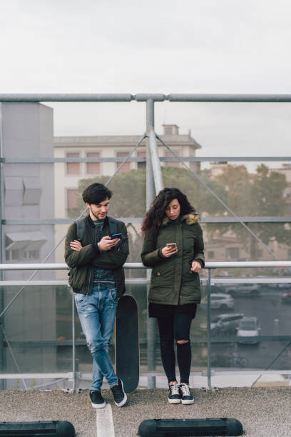 teenagers friends using smartphones together - smartphone addiction not groups stock pictures, royalty-free photos & images