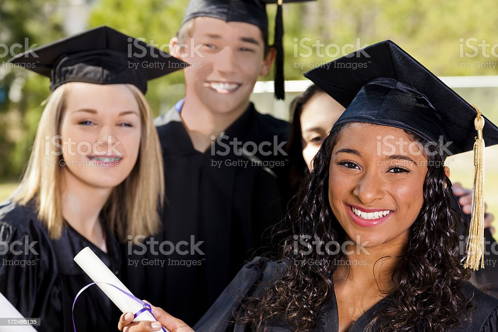 Teenagers graduation. High school, college. Friends. Cap, gown, diploma. royalty-free stock photo