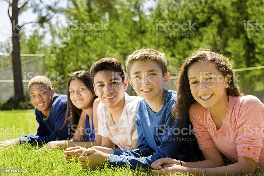 Teenagers: Group of friends hang out together. Park or campus. stock photo