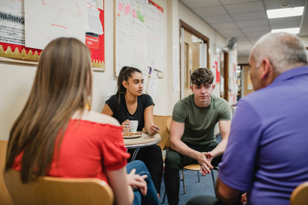 teenagers group therapy at the community centre - teen counseling stock photos and pictures