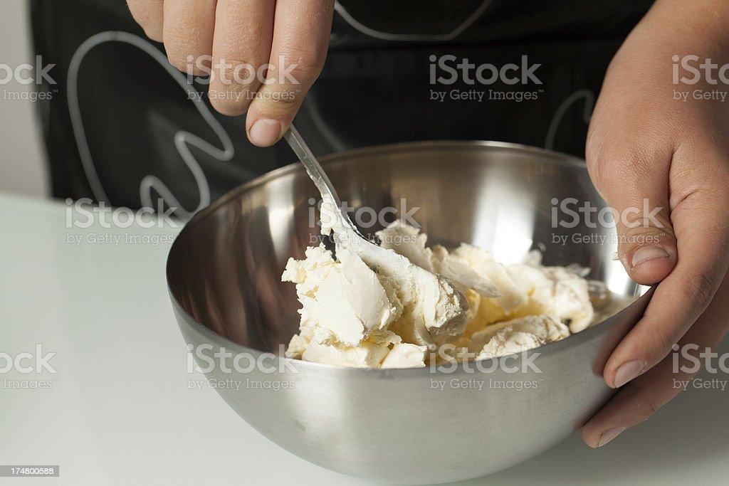 Teenager's Hands Amalgamating Mascarpone into a Bowl stock photo