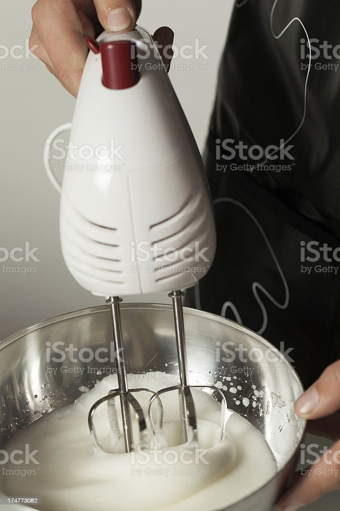 Teenager's Hands Whipping Albumen in a Metallic Bowl royalty-free stock photo