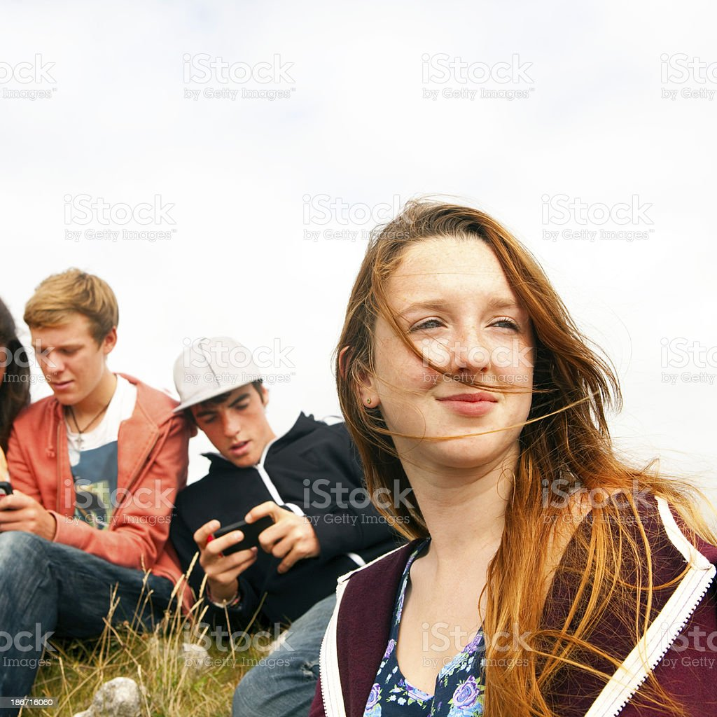 Teenagers hanging out outdoors royalty-free stock photo