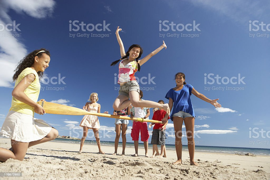 Teenagers having fun on beach royalty-free stock photo
