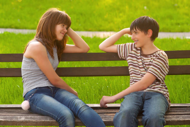 Teenagers having fun outdoors Teenagers having fun outdoors on a sunny spring day. cute teen couple stock pictures, royalty-free photos & images