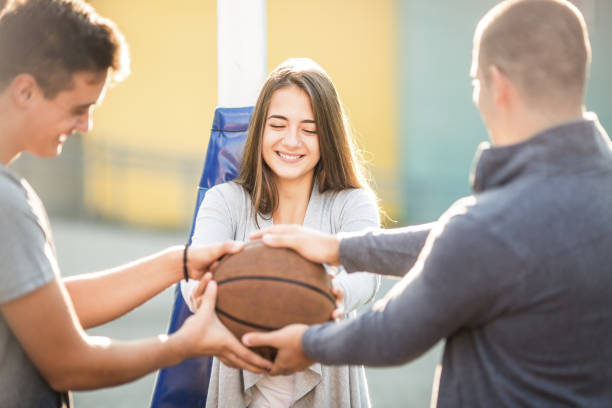 Teenagers having fun with basketball ball stock photo