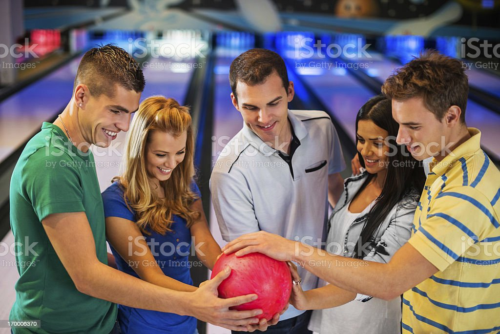 Teenagers holding bowling ball. stock photo