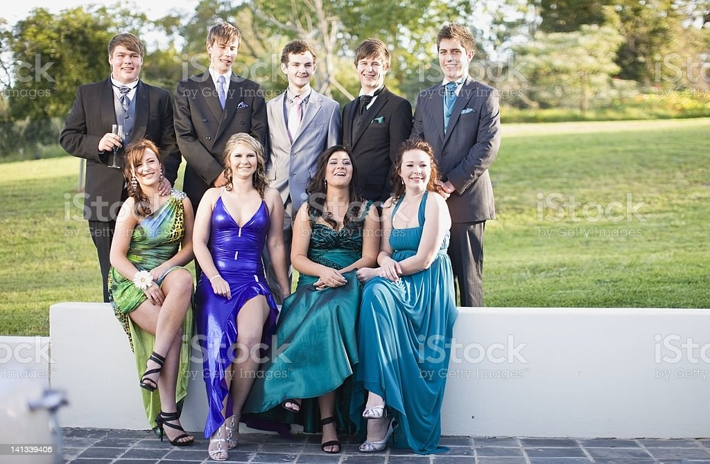 Teenagers in formal wear posing together stock photo