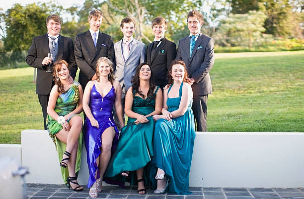 teenagers in formal wear posing together - prom stock photos and pictures