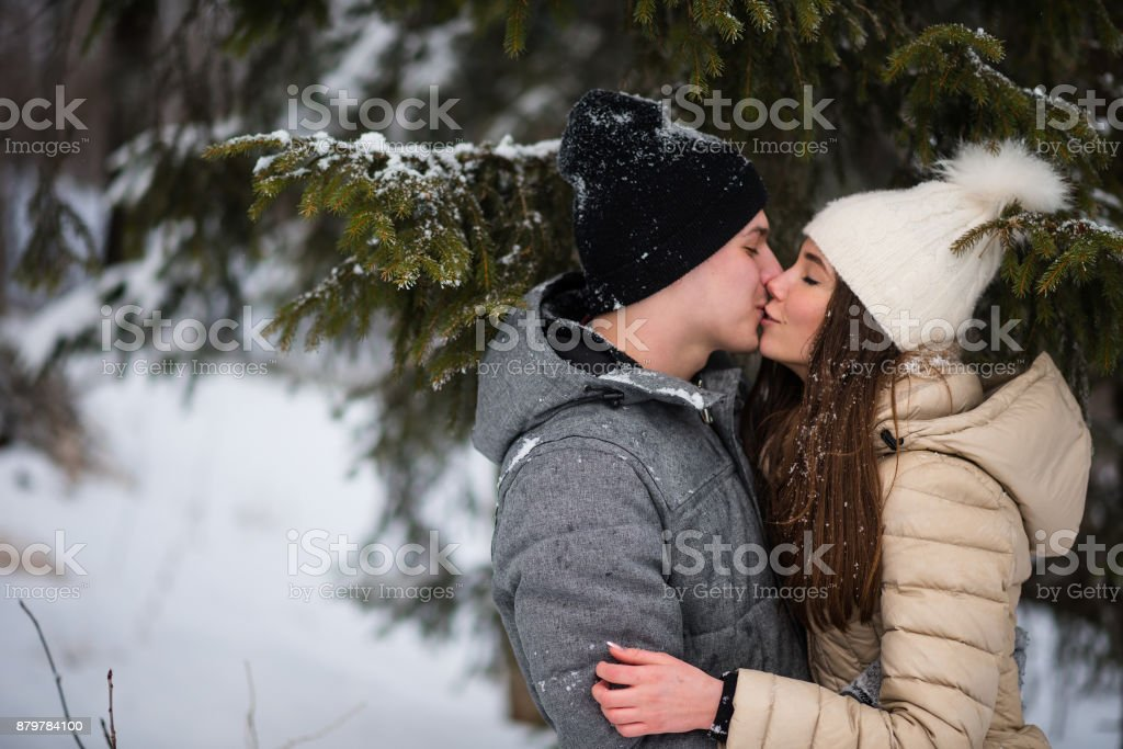 Teenagers in love kissing each other stock photo