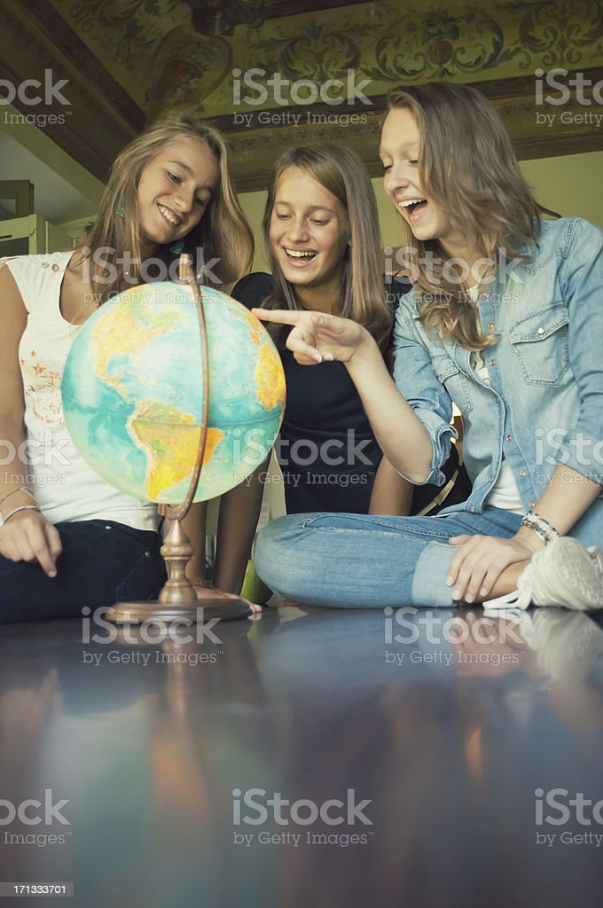 Teenagers Looking a Globe royalty-free stock photo