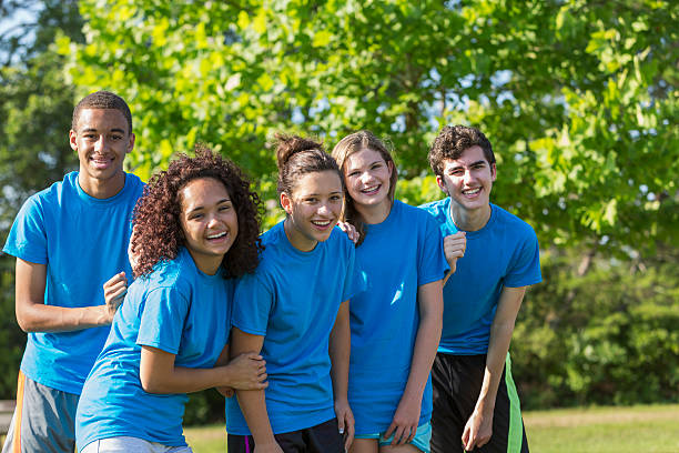 Teenagers Multi-ethnic group of teenagers (14 to 17 years).  Girl 2nd from left is physically challenged, an amputee. teenagers only stock pictures, royalty-free photos & images