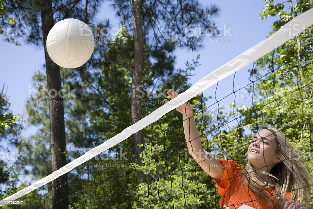 Teenagers playing volleyball in the summer royalty-free stock photo