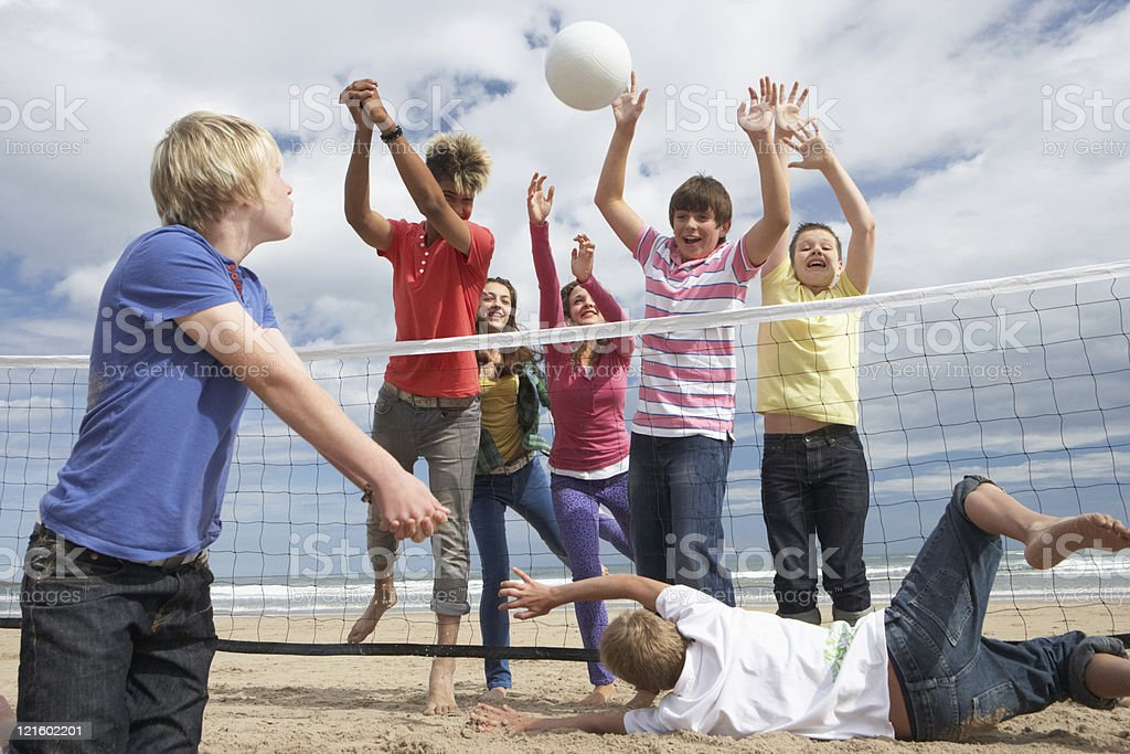 Teenagers playing volleyball royalty-free stock photo