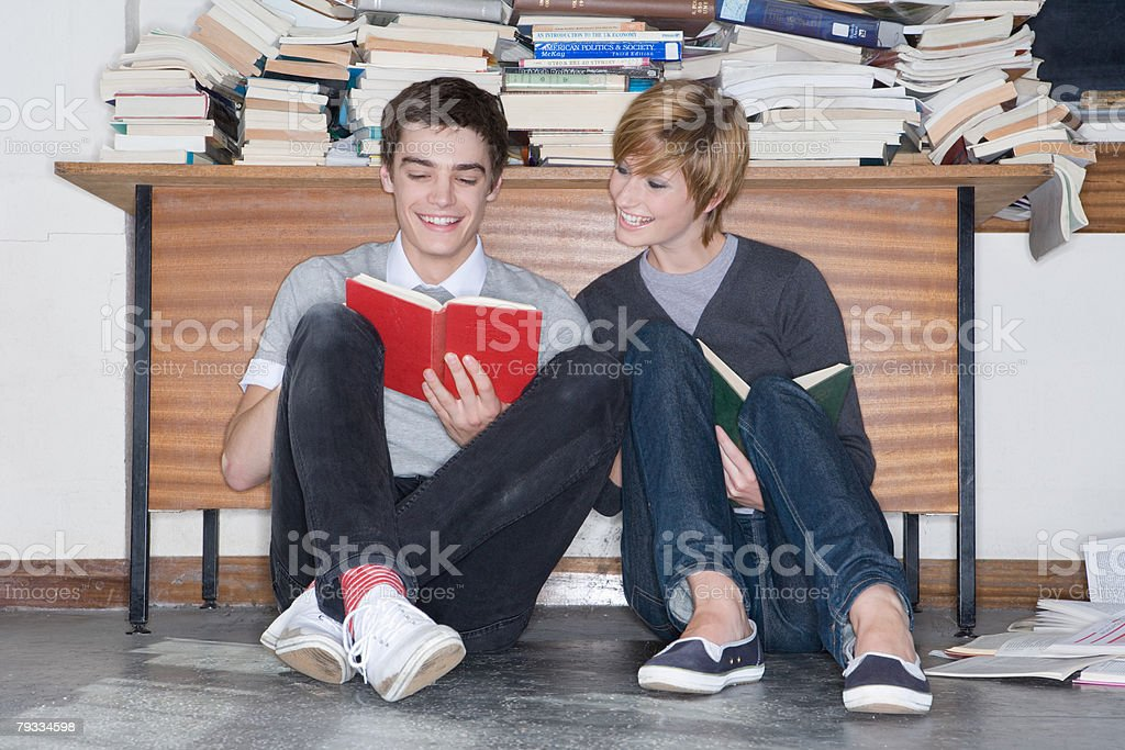 Teenagers reading a book royalty-free stock photo