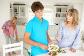 Teenagers reluctant to do housework being scolded by mother