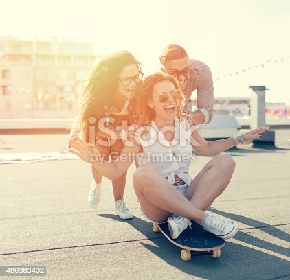 Girls having fun on a skateboard