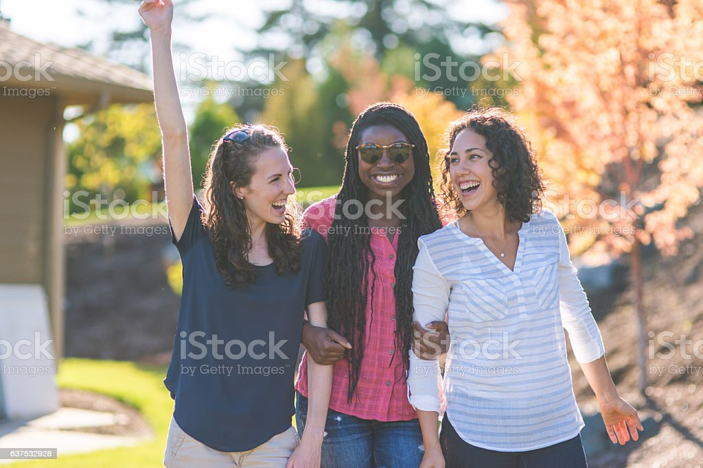 Teenagers spending time together outside during summer stock photo
