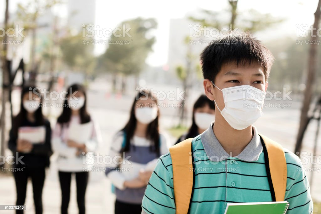 teenagers student wearing mouth mask against smog in city stock photo