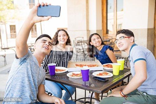 istock Teenagers taking selfie at restaurant 1018287140