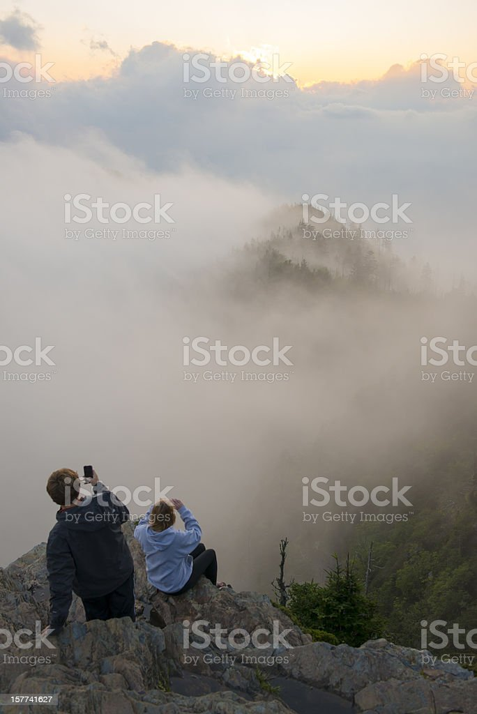 Teenagers using camera phones in Smoky Mountains stock photo