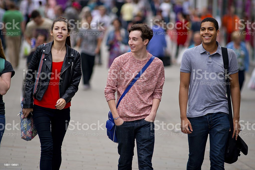 teenagers walking through a city centre stock photo