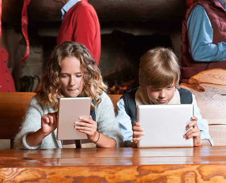 Teenagers With Digital Tablets Stock Photo - Download Image Now