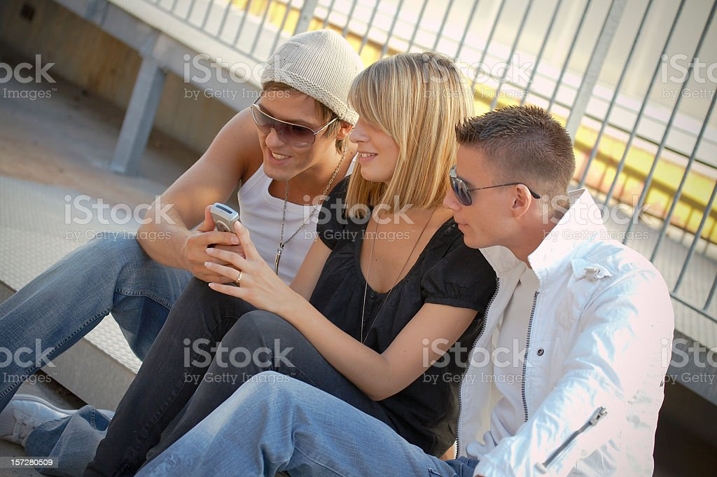 Teenagers with mobile phone royalty-free stock photo
