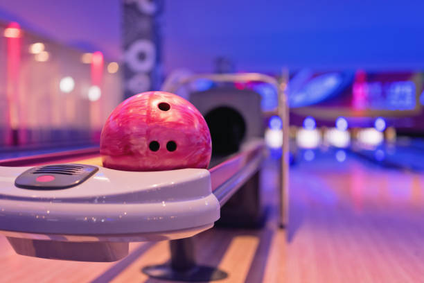 Teennager holding bowling ball. stock photo