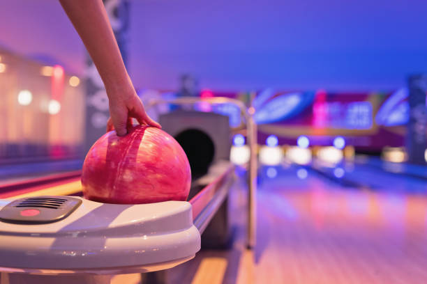 Teennnager holding bowling ball. stock photo