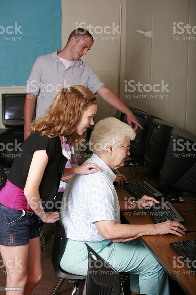 Teens and Seniors Working in Computer Lab royalty-free stock photo