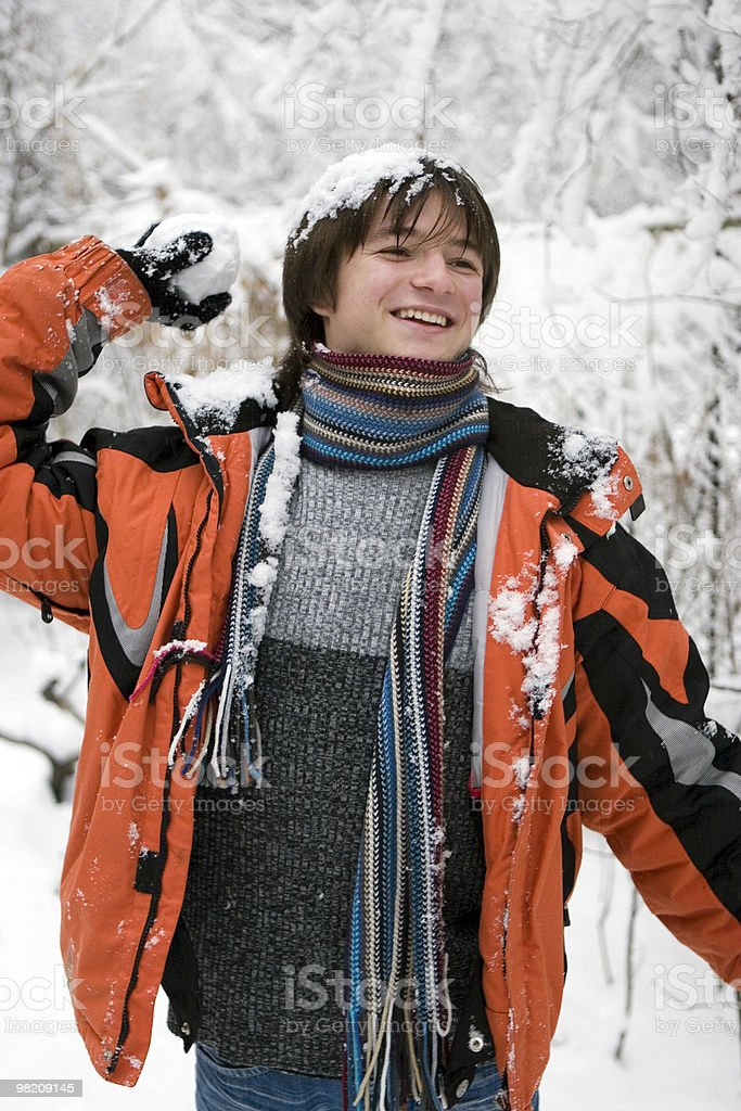 teens boy in scarf with snowball stock photo