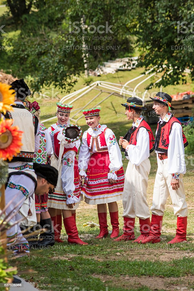 Teens dressed in Ukrainian embroidered costume clothes stock photo