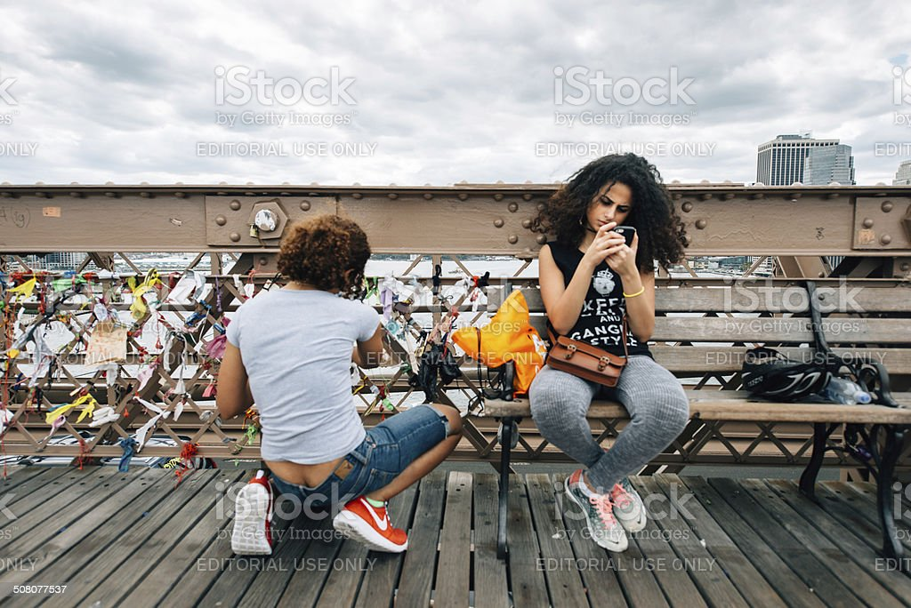 Teens Hanging out at The Brooklyn Bridge royalty-free stock photo