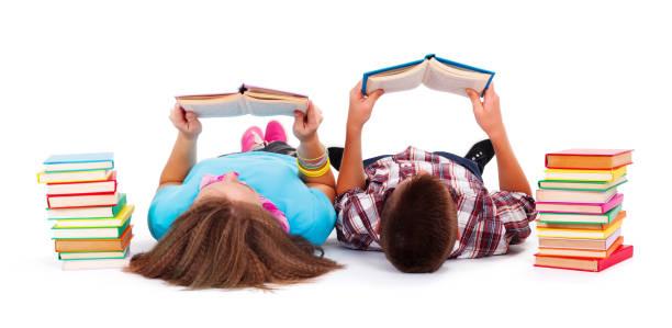 Teens reading books stock photo