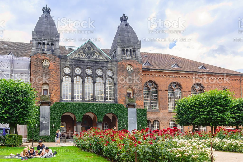 Teens resting on the lawn in front of Royal Library royalty-free stock photo