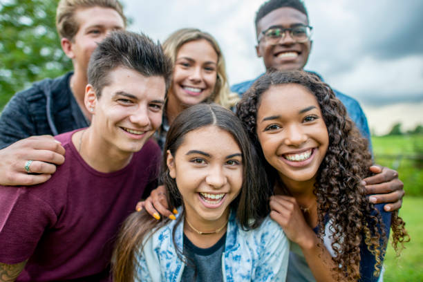 teens smiling together for a group portrait - beautiful college girl pics stock photos and pictures