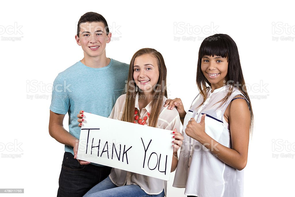Teens:  Three teenagers hold a 'Thank You' sign.  White Background. royalty-free stock photo