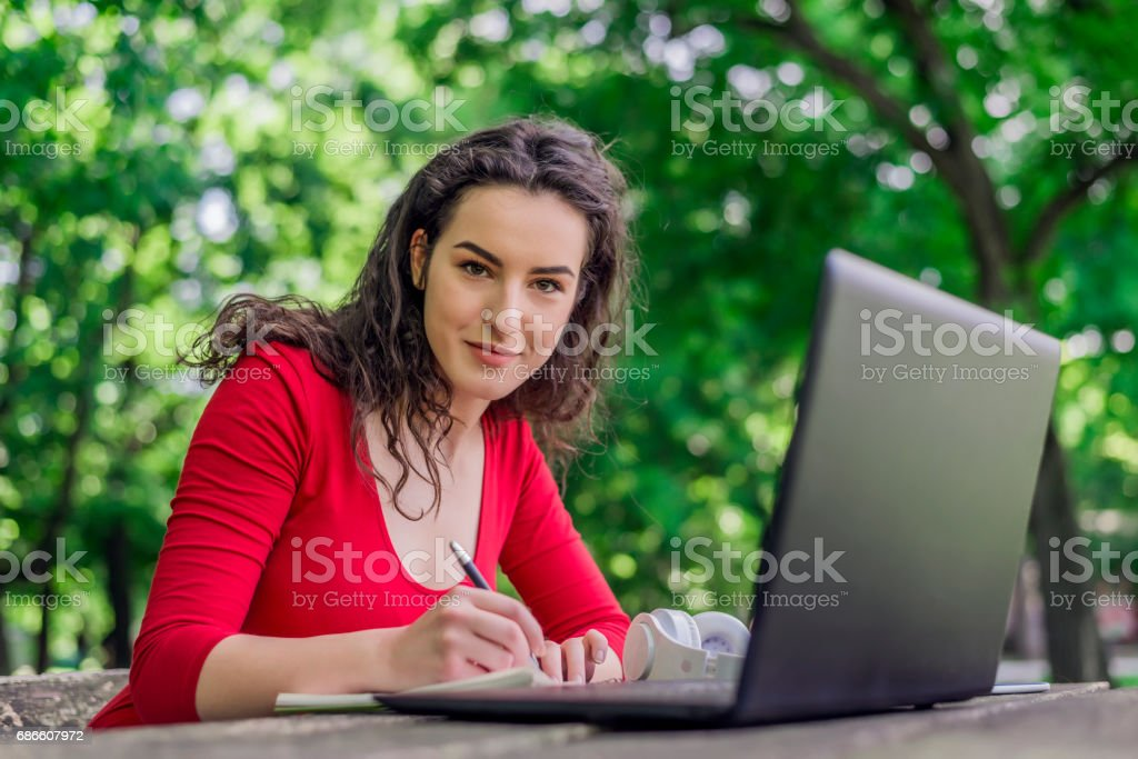 Teens Using Social Media, Jotting in her journal royalty-free stock photo