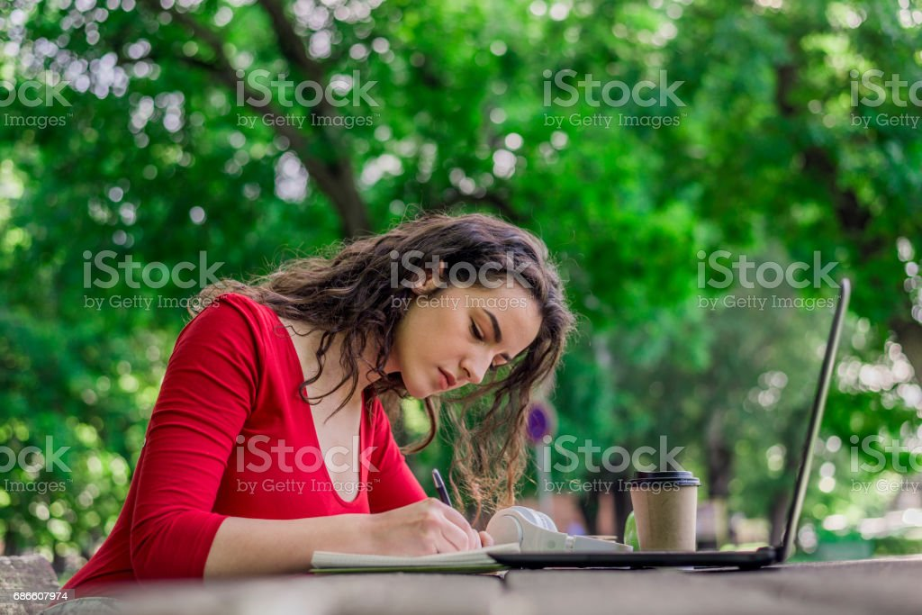 Teens Using Social Media, Journalism in the park royalty-free stock photo