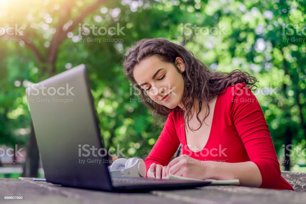 Teens Using Social Media, My study room is the park! royalty-free stock photo