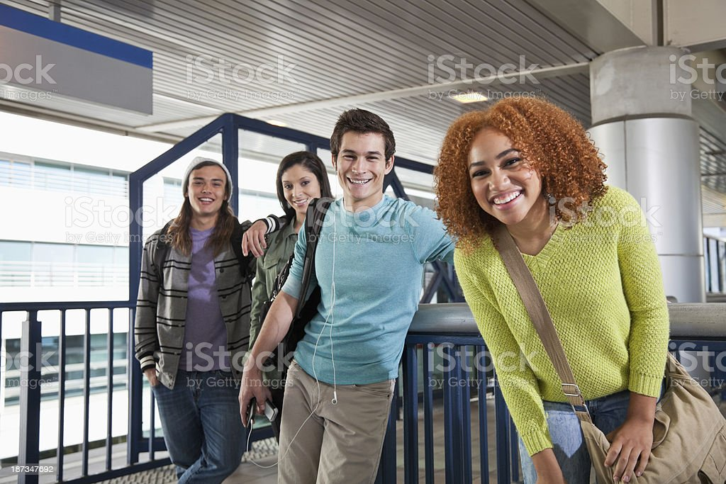Teens waiting for tram royalty-free stock photo