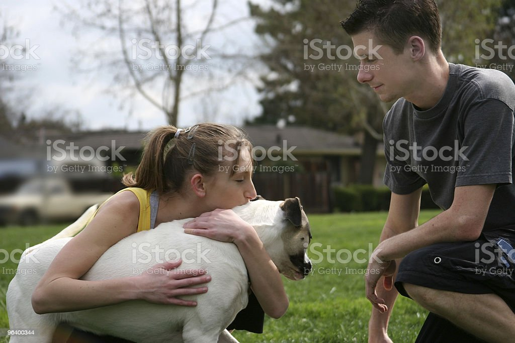 Teens with a dog - Royalty-free Adult Stock Photo