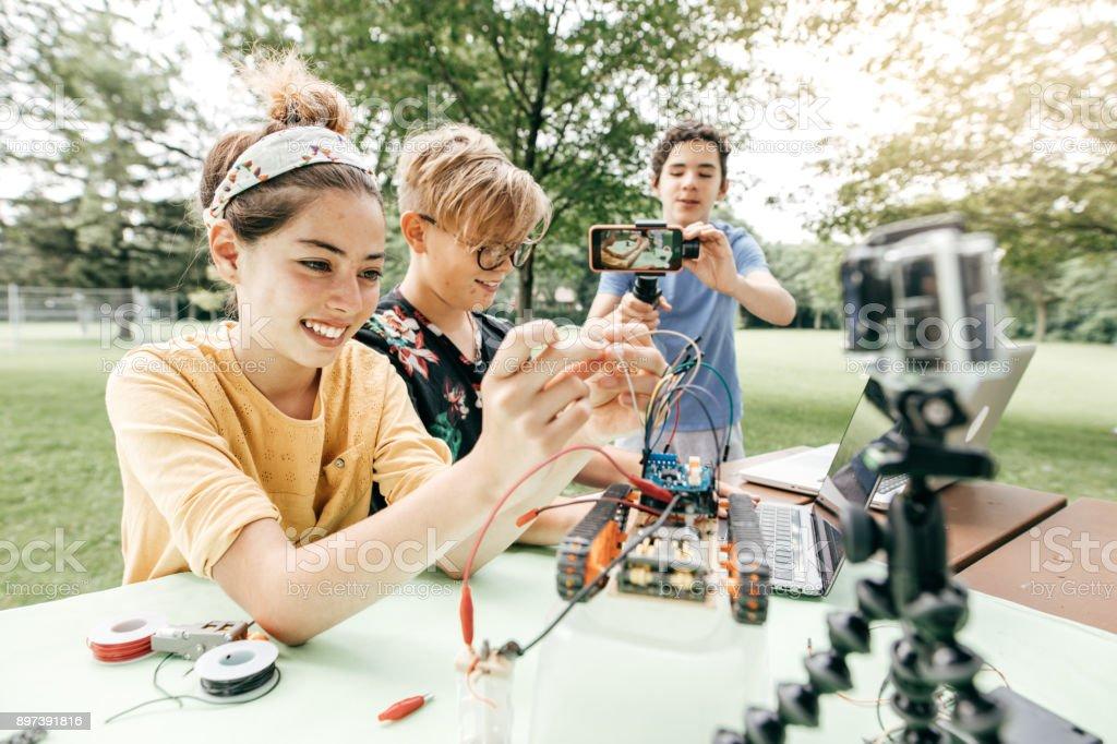 Teens working on robotics project stock photo
