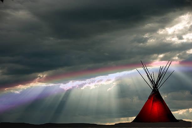 teepee and raining, dark,  sunset, rainbow, light in teepee - indianer tipi stock-fotos und bilder