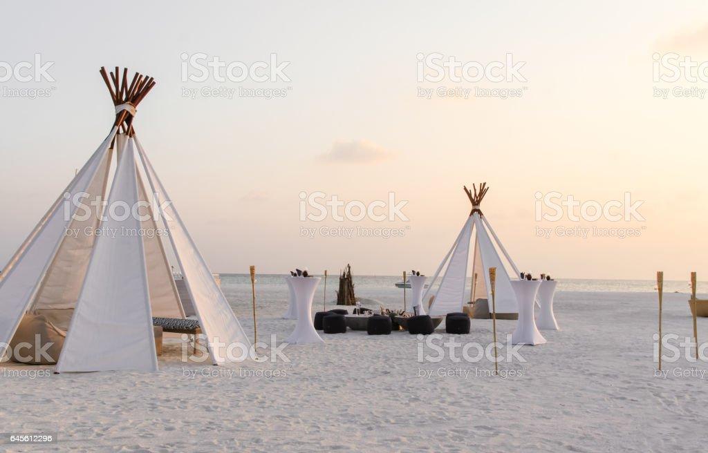 Teepee tent on the beach stock photo