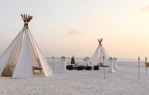 Teepee tent on the beach stock photo